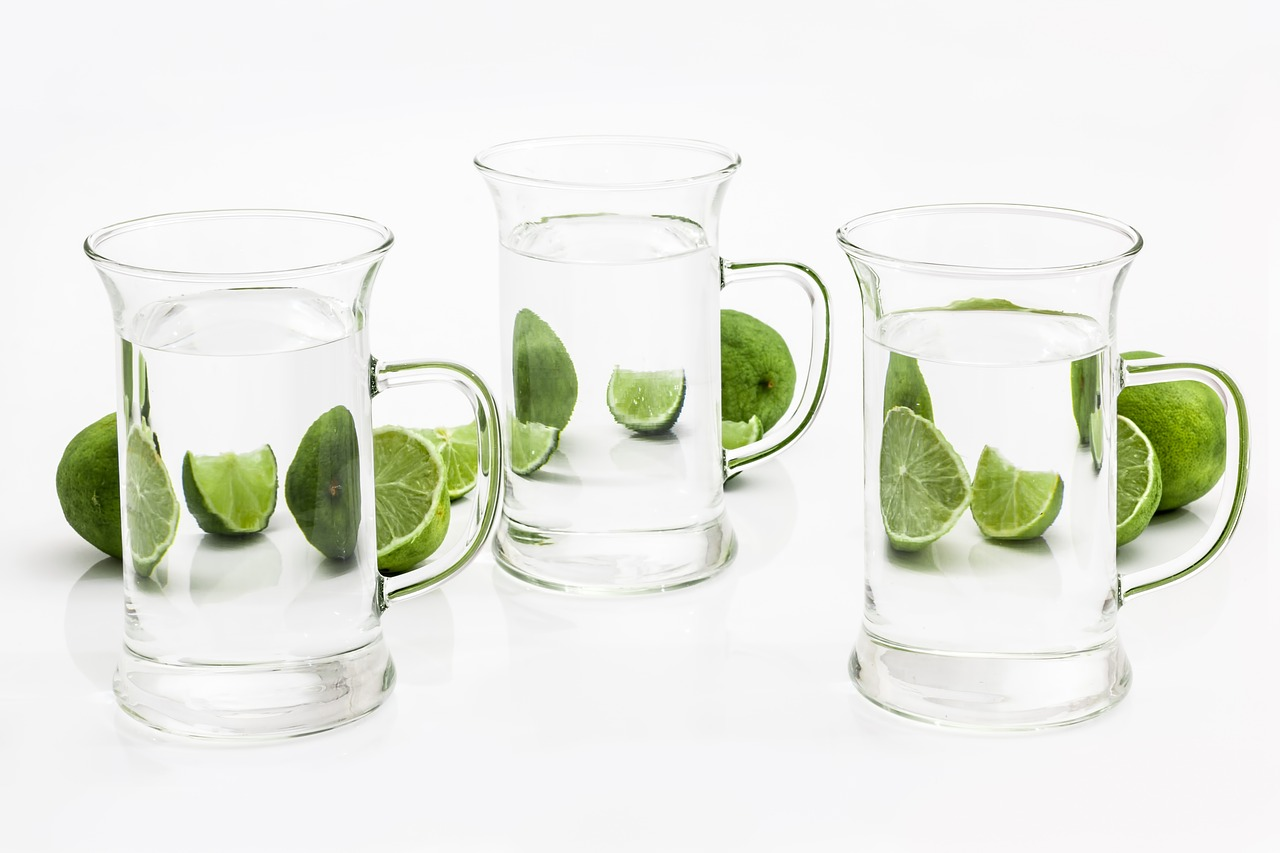 three glasses of water with lime